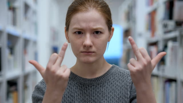 Frustrated Young Woman Showing Middle Finger in Anger Frustrated Young Woman Showing Middle Finger in Anger middle finger stock videos & royalty-free footage