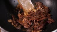 istock frying beef in oil in a pan 1255866013