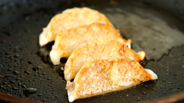 Frying dumplings in pan