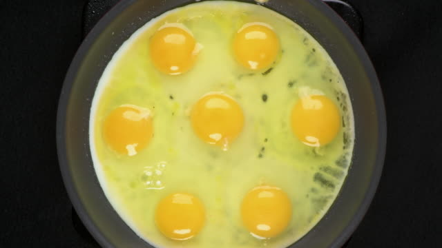 Frying Eggs In Timelapse video