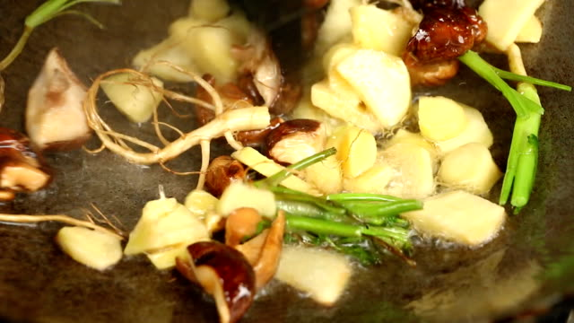 Frying  ginger shiitake and celery root  in pan video