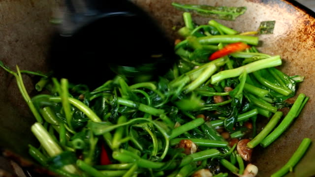 frying morning glory in pan - thai food stock videos and b-roll footage