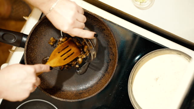 Frying pan on the stove. We spread the chopped mushrooms. video