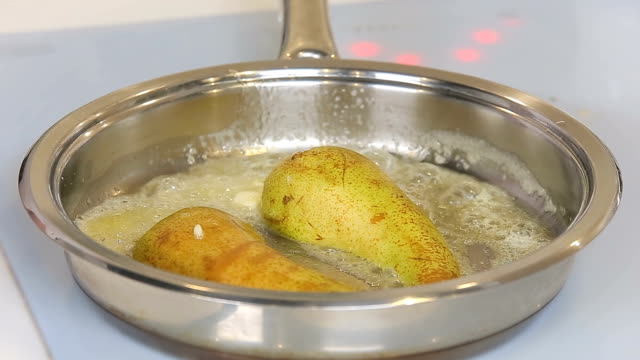 Frying pear with butter in a pan video