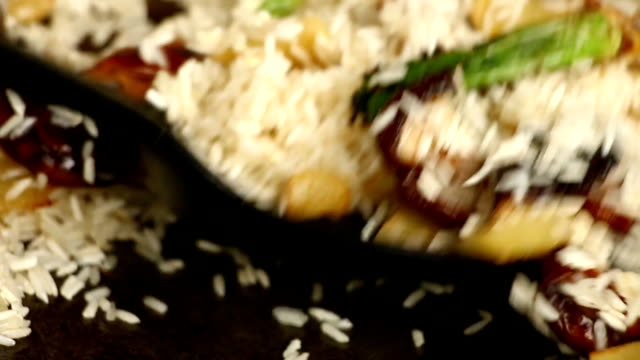 Frying rice with ginger shiitake and celery root  in pan video