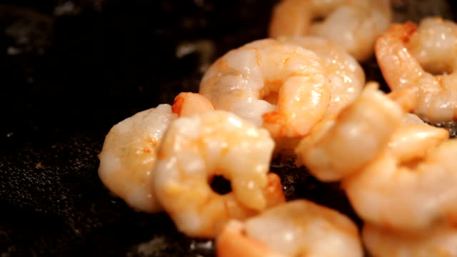 Frying shrimps Frying delicious fresh shrimps in a hot oiled pan (Ambient audio included) shrimp seafood stock videos & royalty-free footage