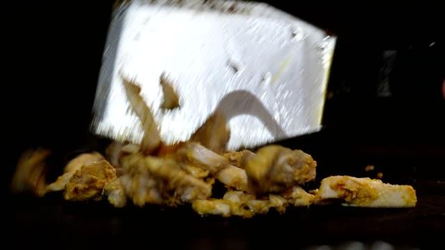 Frying the chicken in the restaurant kitchen