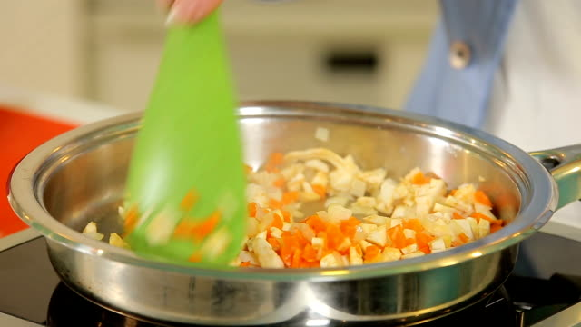 Frying vegetables in a pan video