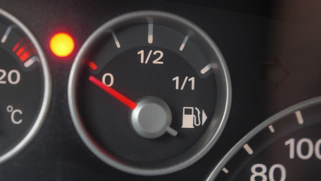 Fuel Gauge and Indicator Lights of Starting and Stopping Car Close Up