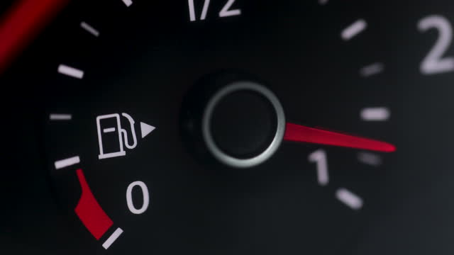 Fuel Gauge Car Dashboard Fills up. Red Light Turn On When Tank is Full or Vehicle Activated. Close Up petrol meter on black background