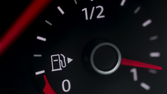 Fuel Gauge on Car Dashboard. Fuel Gauge and Indicator Lights of Starting and Stopping Car Close Up. Fuel Gauge White, Red empty-Full-empty Car Dashboard on Black background