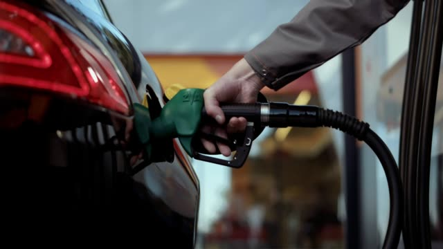 Fuel is poured into the tank Fuel is poured into the tank refueling stock videos & royalty-free footage