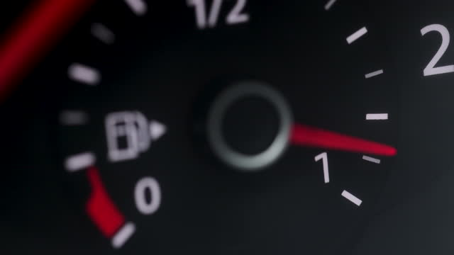 Fuel level sensor in the car. Full tank truck. Fuel gauge car dashboard show fuel empty to full. Close up gasoline meter on black background. Full tank of gas for long distance drive concept