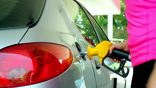 Fuel nozzle add fuel in car at gas station video