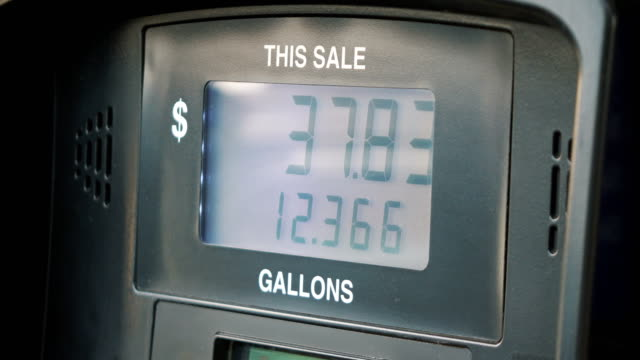 Fuel Pump Counting Dollars in 4K video