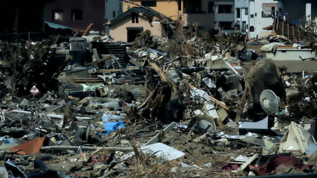 Fukushima In Japan after the tsunami, a destroyed city with a lot of debris, fragments Destroyed buildings and houses after the tsunami in Japan. City of Fukushima is ravaged after the disaster. No one in the town, an evacuate city. A lot of dust, debris and trash. earthquake stock videos & royalty-free footage