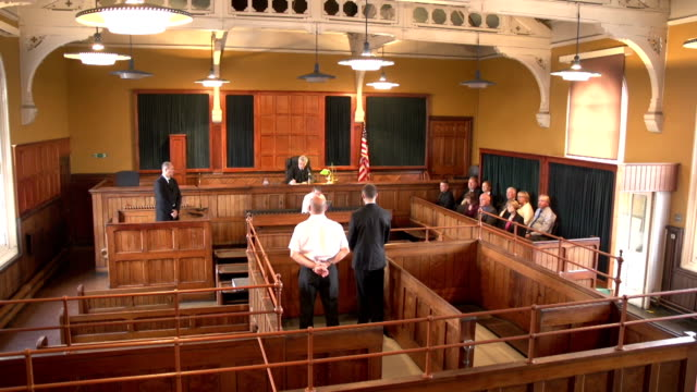 Full Courtroom (USA flag) - Two Shots, Crane Shots Stock HD video clip footage of a Courtroom - Two Crane Shots - With USA flag legal trial stock videos & royalty-free footage