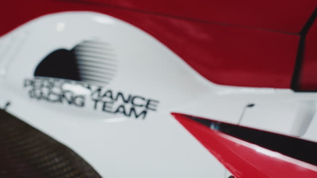 Full frame shot of red and white racing car
