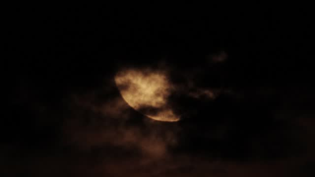 Full moon in black clouds