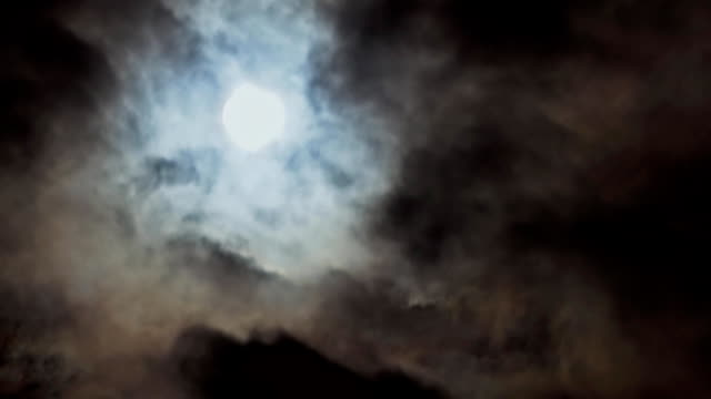 full moon in the night sky, full moon, night sky, the motion of clouds in the night sky against the background of a bright moon - moon stock videos & royalty-free footage
