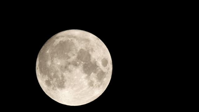 4K - Full moon moves across the night sky video