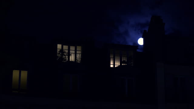 Full moon over Champs Elysees Paris France building home night
