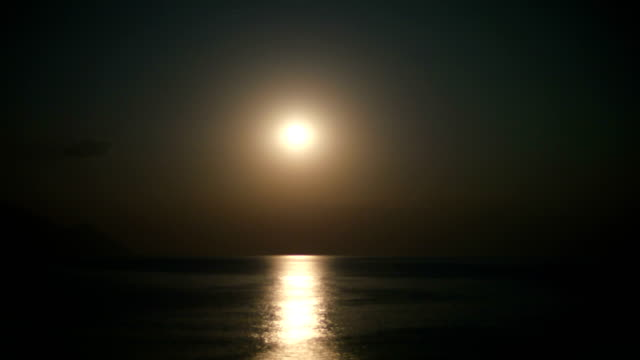 full moon rise over sea 4k
