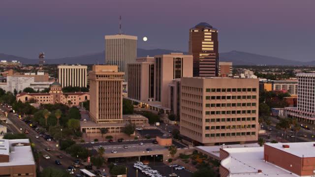 Full Moon Shining on Downtown Tucson at Twilight