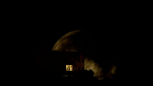 Full Moon Time Lapse behind the mystery house, moving clouds video