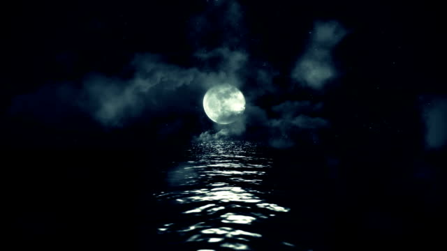 Full Moon with Starry Night Reflecting Above the Water with Clouds and Mist video