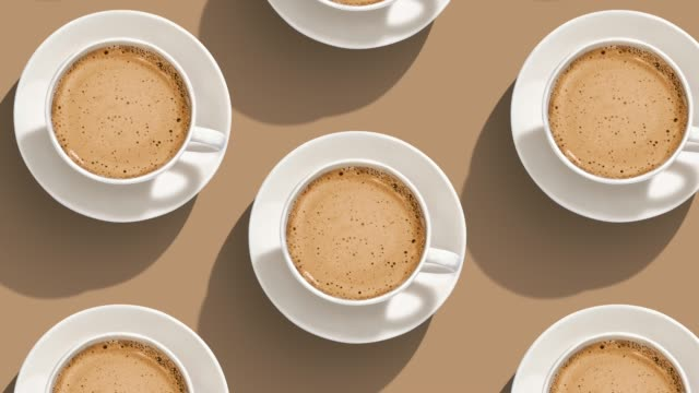 Full of coffee cup Full of coffee cup on color background. From top view coffee stock videos & royalty-free footage
