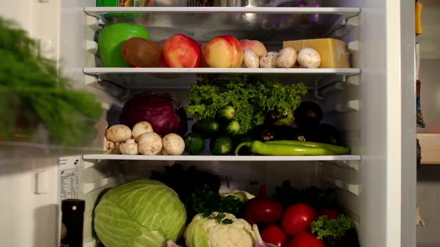 Full refrigerator of fresh healthy food. Slow mo. video