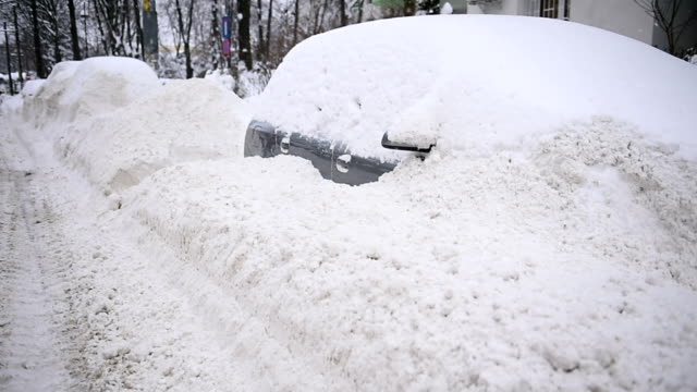 Full snow covered cars video