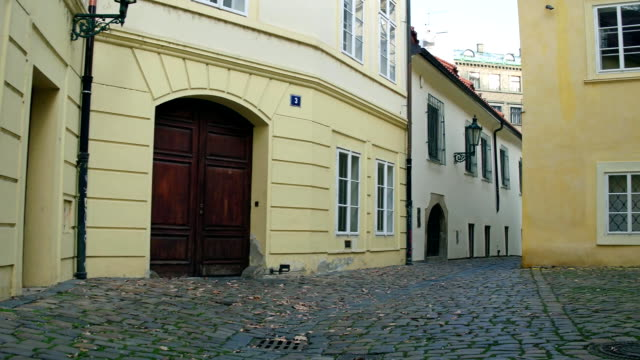 FullHD steadicam shot of narrow cobblestone paved empty street. Old european city view video