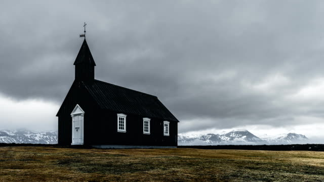 FullHD Time lapse film video movie of Black Church Of Budir, Iceland. Famous black church of Budir at Snaefellsnes peninsula region in Iceland
