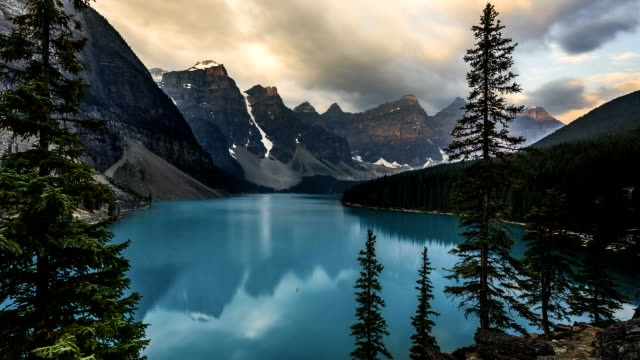 Video FullHD Time lapse film video movie of Sunrise Moraine Lake Banff National Park with reflection and golden hour