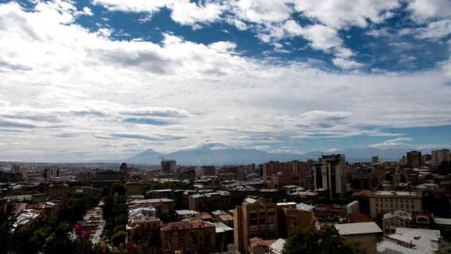 FullHD Timelapse of clouds above the city with huge mountain behind video