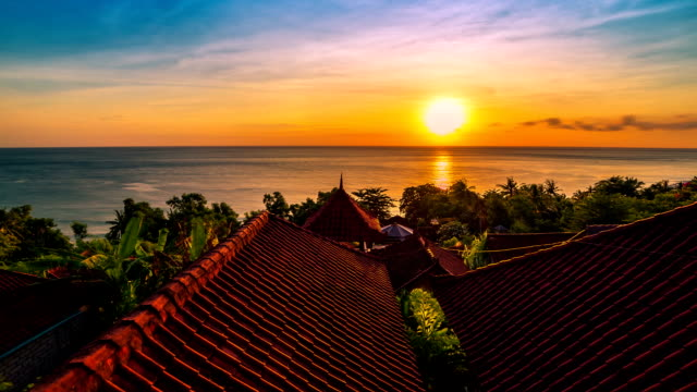 FullHD Timelapse. Sunrise overlooking the roofs of the bungalows and the Indian Ocean. 15 July 2015, Bali, Indonesia video