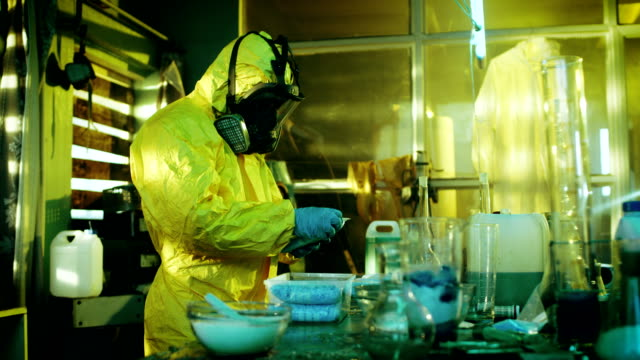 Fully Armed Special Anti-Narcotics Task Forces Soldier Arrests Clandestine Chemist in the Drug Producing Underground Laboratory. Chemist Raises Hands and Surrenders. A lot of Functional Drug Production Equipment is Standing Around. video
