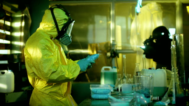 Fully Armed Special Anti-Narcotics Task Forces Soldier Arrests Clandestine Chemist in the Drug Producing Underground Laboratory. Chemist Raises Hands and Surrenders. A lot of Functional Drug Production Equipment is Standing Around. Shot in Slow Motion. video