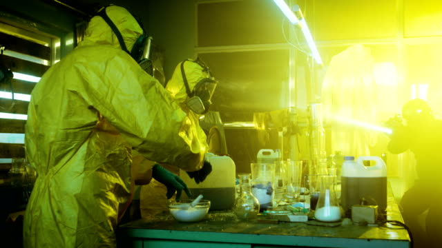 Fully Armed Special Anti-Narcotics Task Forces Soldier Arrests Two Clandestine Chemists Working in the Drug Producing Underground Laboratory. A lot of Drug Production Equipment is Lying around. video