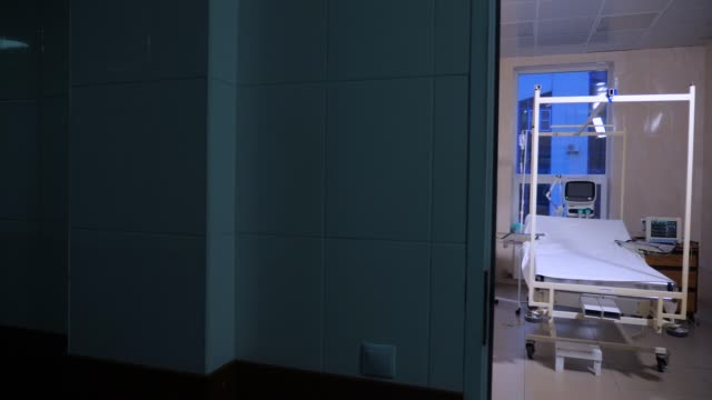Fully-equipped hospital ward with empty bed. Burn clinic background.