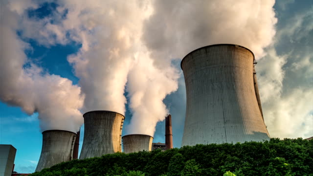 Fumes Giant cooling tower of a coal fired power station.  coal stock videos & royalty-free footage