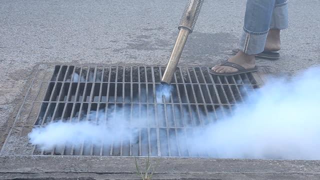 fumigate mosquito killing - insetticida video stock e b–roll