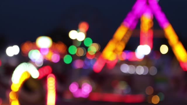 fun fair defocused - luna park video stock e b–roll