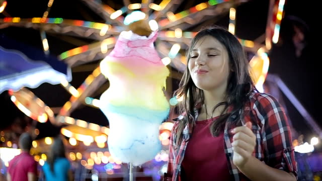 Fun in amusement park Fun in amusement park cotton candy stock videos & royalty-free footage