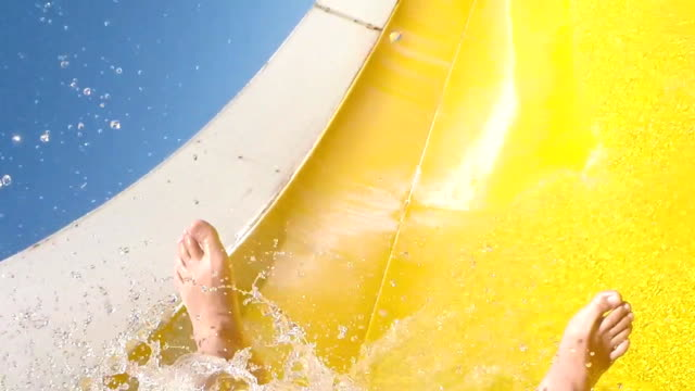 Fun on the water slide, slow motion video