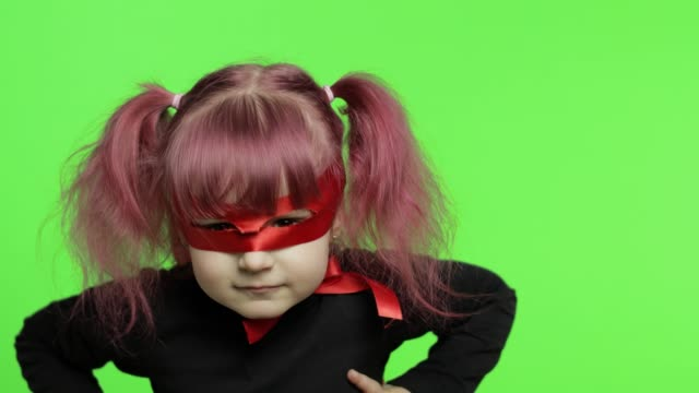 vídeos de stock e filmes b-roll de funny child girl in costume and mask plays super hero. national superhero day - baby super hero