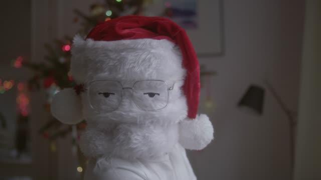 funny christmas santa in eyeglasses - simbolo concettuale video stock e b–roll