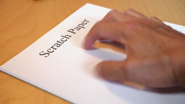 Funny Concept Hand Scratching on Stack of Blank Paper video